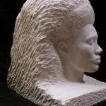 Grace Jones head sculpture in stone.
